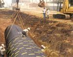 This successful steel pipe installation was completed following typical safety procedures. Photo: National Corrugated Steel Pipe Association