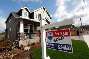 Homes are seen for sale in the northwest area of Portland, Oregon, in this file photo taken March 20, 2014.  REUTERS/Steve Dipaola/Files