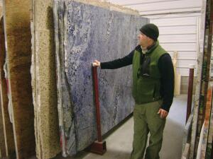 Remodeler Chris Newcomer points out the unique veining in a piece of Blue Bahia, a level-five granite. Clients need help choosing from graniteís thousands of color and veining options.