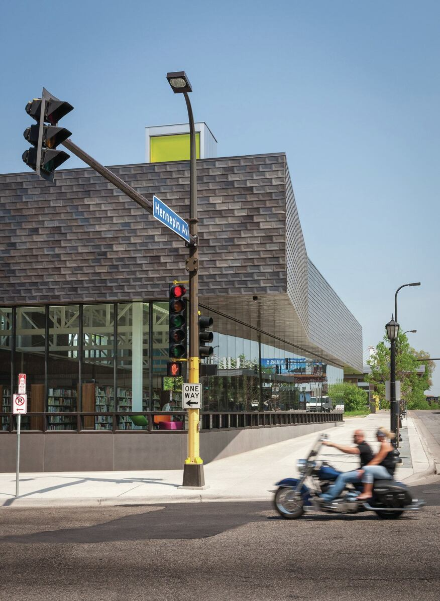 The library is located on Hennepin Avenue, one of the longest thoroughfares in Minneapolis. It is sited between a landscaped pedestrian mall and a bustling transit hub, making for lots of foot traffic.