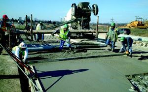 For fixed-form placements, a tube roller, straightedge, and float can be used to strike off and finish the concrete surface.
