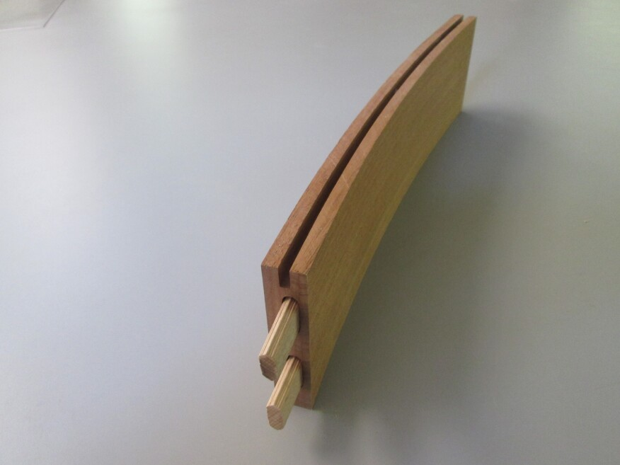 Each curved rail is formed from five laminations. The center lamination is ripped slightly narrower than the