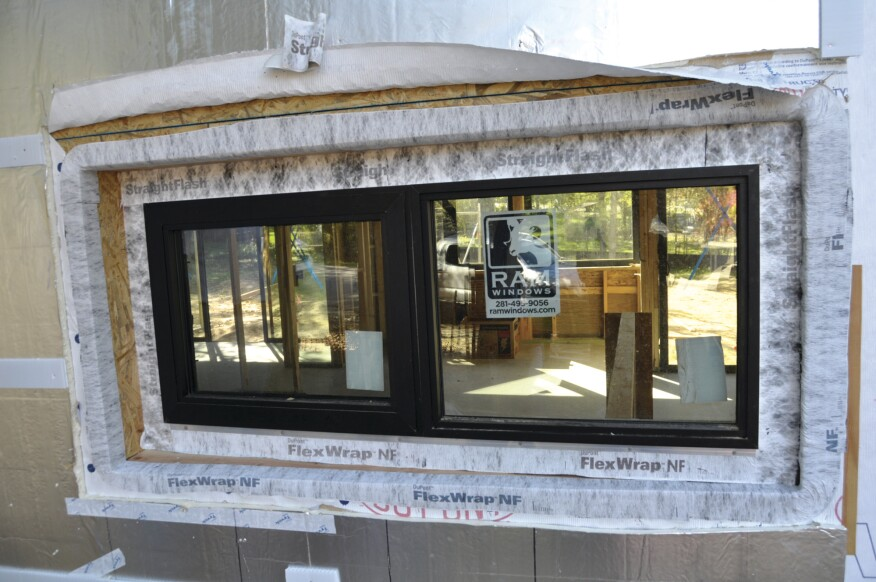 To remedy the botched window job on his site, the author worked with the local Tyvek distributor. The housewrap was peeled back and FlexWrap applied along the edges of the recessed opening and over the window flanges.