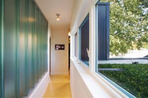 Interior hallways are awash in natural light and encourage airflow throughout the house.