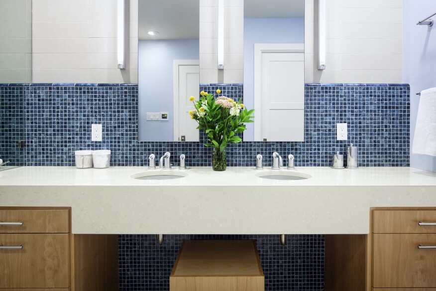 Staying consistent with simple, natural finishes, this bathroom