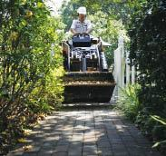 Figure 3. Deck builders often work in backyards with limited access. If the path is wide enough for walking, odds are a subcompact loader can get through.