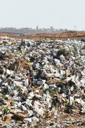 A giant mound of trash in a landfill.