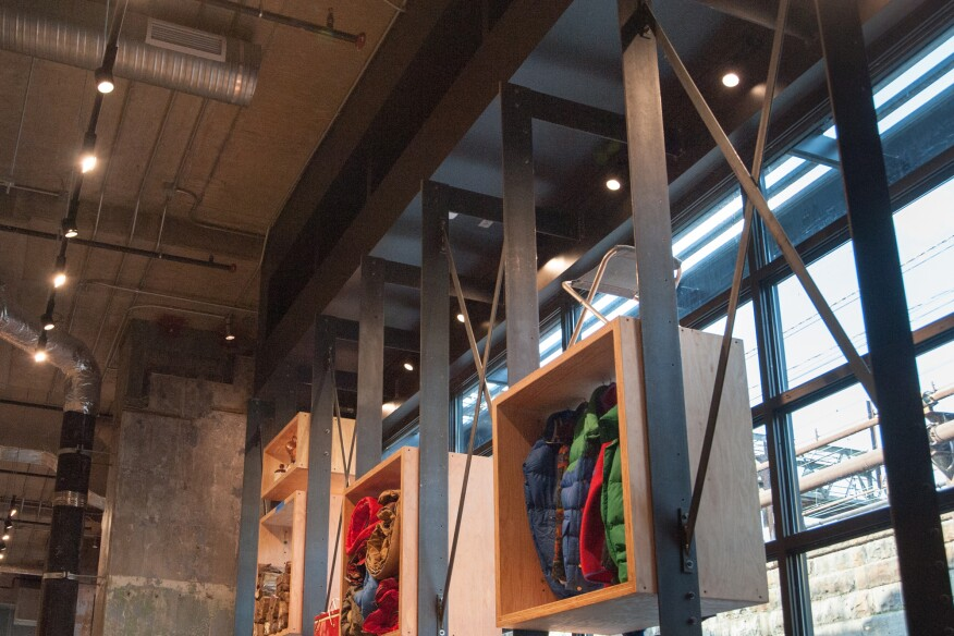 To showcase merchandise in window frontage, REI created a steel fin-wall system with a slim profile.