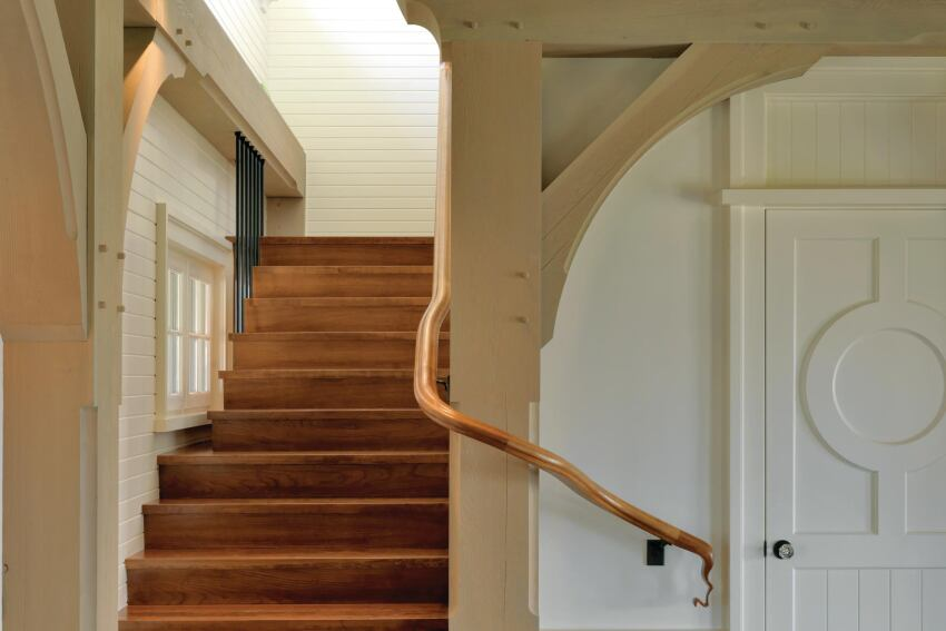 This Shingle style house in Massachusetts features a well-composed custom staircase