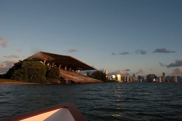 The stadium sits on Virginia Key, offering views of the Miami skyline in the distance.