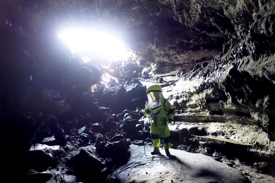 Exploring a cave formed in the lava fields of Mauna Loa.