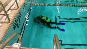 Drains away: Here's another example of outfitting a pool for VGB compliance. This time the diver, Steve White, works in a commercial pool.