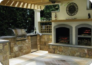 This outdoor kitchen pavilion from McHale Landscape Design features cooking and entertaining areas, wine storage, and a fireplace.