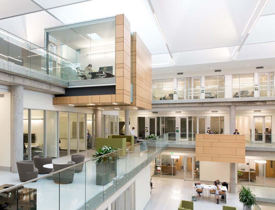 home lighting designer. Cantilevered team workrooms and projecting counter areas  both clad in light wood act as 2017 AL Design Awards Baylor University Paul L Foster Campus for