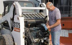 Daily maintenance procedures include cleaning machines and checking oil and other fluid levels.