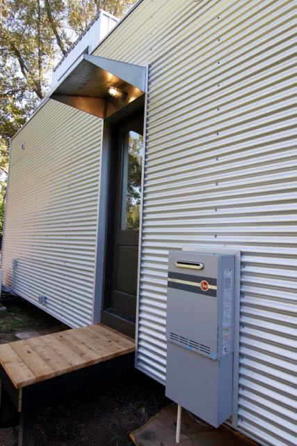 Rheem Tankless installed near the back door of this house.
