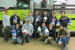 Silvi Group's Aidan Kilcoyne with Flagtown (Hillsborough, NJ) Volunteer Firefighters: Deputy Chief Dave Foelsch, Anthony Valentine (Sitting on step of tanker), Lieutenant Eric Regiec, Asst. Chief Everett Heider, Tyler Riordan, Joe Spence and Rob Slovik (Holding 2 turkeys) Kneeling Row: Jay Spagnuolo, James Boyda, Nick Jandoli, Tom Slinsky, and Will Davis.