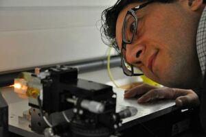 Dr. Gilberto Brambilla peering at a silicon nanofiber.