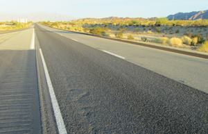 "California's Interstate 10, the ""Sunset Route,"" has seen a dramatic increase in traffic over the past three decades. The state's DOT (Caltrans) has addressed some of the resulting wear and tear with economical ""scrub seal"" repairs using 100% recycled asphalt pavement. Here, the treatment has been applied to the outside (left) lane and shoulder of the highway. Photos: Western Emulsions Inc."