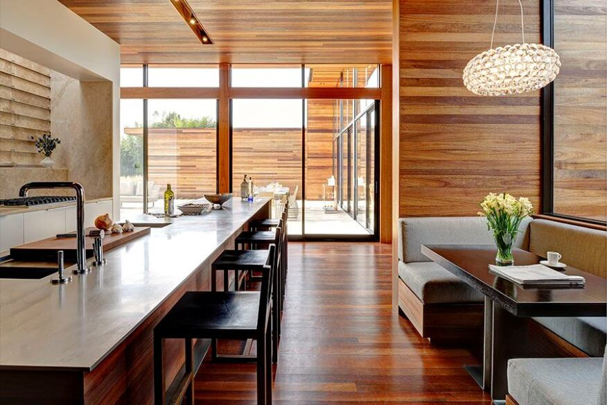 Mahogany siding wraps around the house and continues to the interior, reinforcing an inside-outside connection.