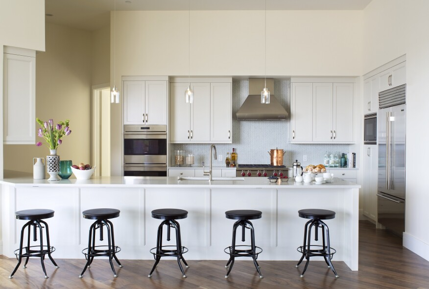An in-unit kitchen echoes the creamy colors used on the building's elevation.