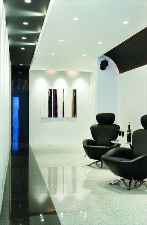 Gray and black granite is used throughout the house, including the basement flooring.