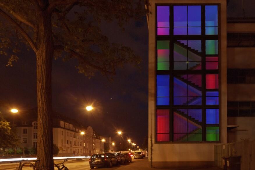 "Light designer Robin Uber's installation ""Bauhaus ""goes"" Mondrian"" converts a transformer station into a Piet Mondrian color tapestry."