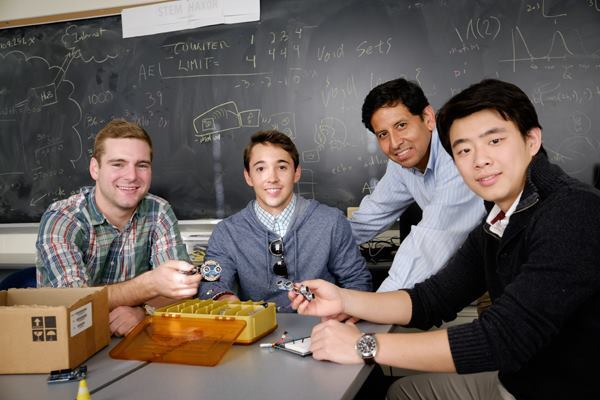The Wake Forest University team of Jack Janes, Dominic Prado, computer science professor Paul Pauca, and Ran Chang display their Human Echo Location Partner device.