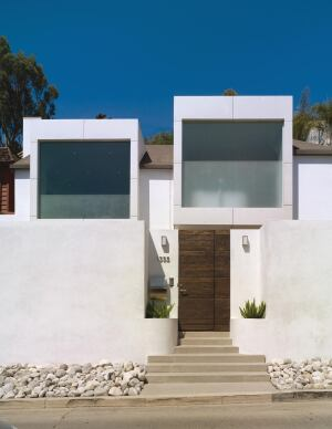 Street Cred  Besides creating a new identity for the front of this home in an urban neighborhood overlooking Hollywood, the cantilevered room-size window boxes shade and protect the interior courtyard and contain lights and speakers for outdoor entertaining.