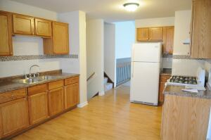 MACK Companies typically buys properties for between $50,000 and $60,000, and spends another $40,000 or so to fix them up and put them back onto the market. The picture shows a renovated kitchen.