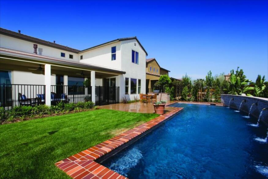 Outside Art: Savory outdoor living spaces have given this project an edge over competitors' products. Landscaped yards are outfitted with timed irrigation systems.