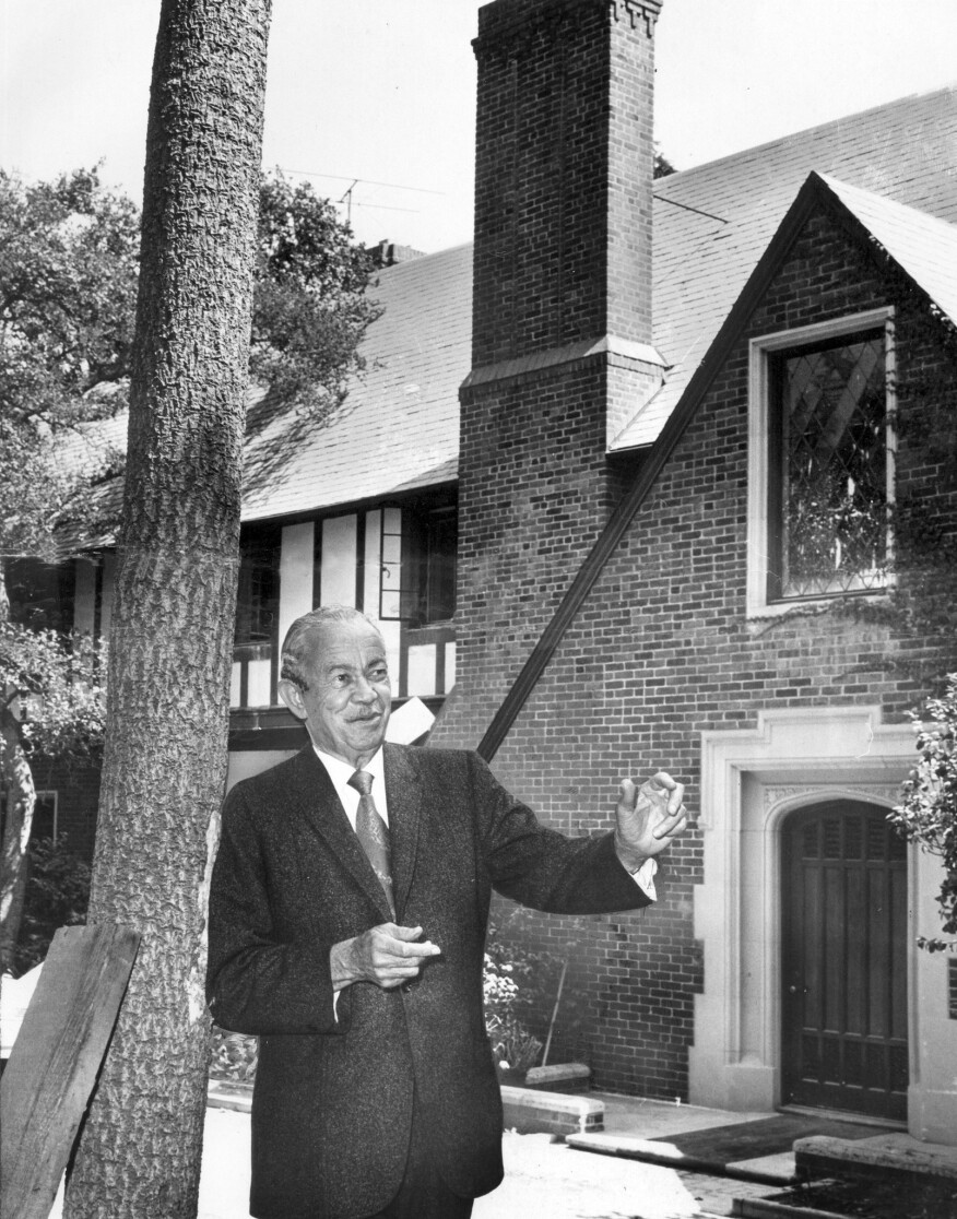 Architect Paul Revere Williams in 1970, standing in front of a restored tudor-style mansion that he designed in Bel-Air in 1928.