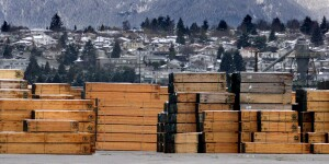** FILE ** Piles of softwood lumber destined for export, are stacked at a Richmond, B.C., Canada lumberyard, March 20, 2002.  Canadian and U.S. officials said Tuesday, July 29, 2003, they have reached a tentative deal to settle a long-running dispute over imports of Canadian softwood lumber used to build homes in the United States. (AP Photo/CP/Richard Lam, File)