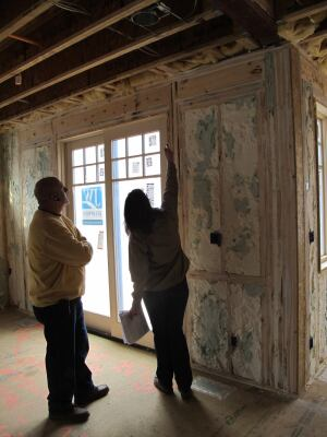Green rater Andrea Foss consults with Bethesda Bungalows' Mark Razmic during the LEED pre-drywall inspection at the KellyGreen house in Chevy Chase, Md.