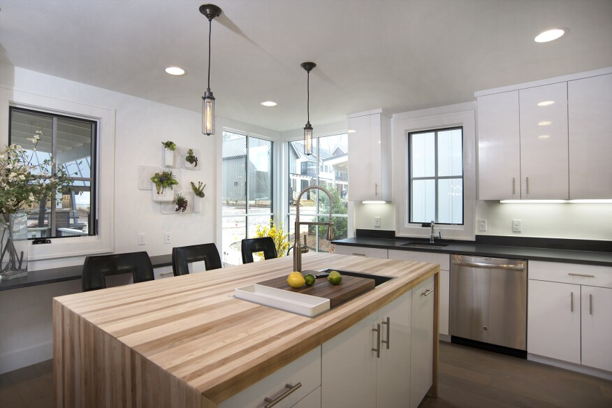 The kitchen features butcher-block surfaces.