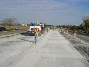 The project in Joliet, Ill., involved sealing the transverse and longitudinal joints, including the curb joint, with hot pour sealant. Shown here is the hot pour sealing of the control joints on the test sections.