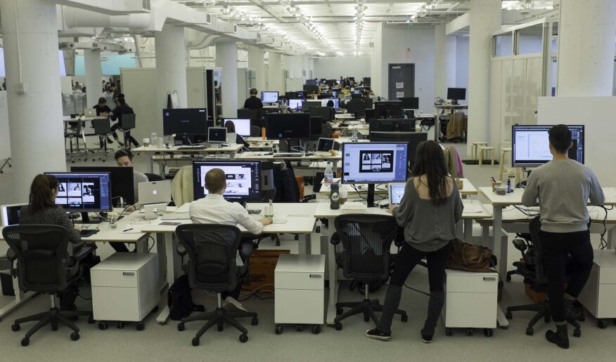 R/GA employees at their adjustable, standing desks installed into the new Hudson Yards office space.