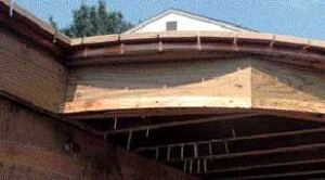 Figure 7. Notched to bend, an aluminum drip edge is installed below the decking to prevent streaking of the fascia. Bituminous roofing membrane on the joists prevents direct corrosive contact, and more membrane atop the drip edge seals the notches.