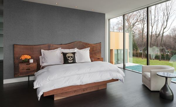 The master suite features black-stained quarter-sawn oak floors, as well as recessed downlights from Lucifer Lighting.