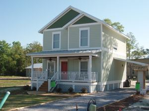 Green features in StalwartBuilt's LEED-Platinum house in Panama City, Fla., include solar panels, geothermal heating and cooling, Energy-Star-rated appliances, low-E windows, spray-foam insulation, and low-VOC paint.