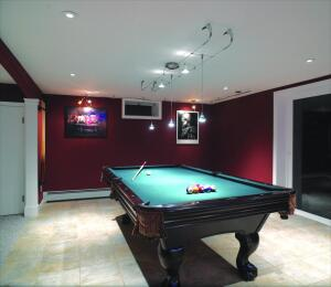 Wes Carver used general recessed lighting for this ceiling (above).