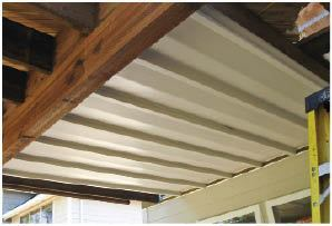 An underdeck drainage system in the ceiling above makes soaking in a hot tub in the rainy Northwest more appealing.