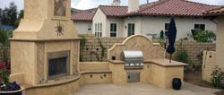 This project features a custom concrete stained and stamped fireplace and outdoor kitchen with built-in seating and a custom concrete poured-in-place medallion water fountain.