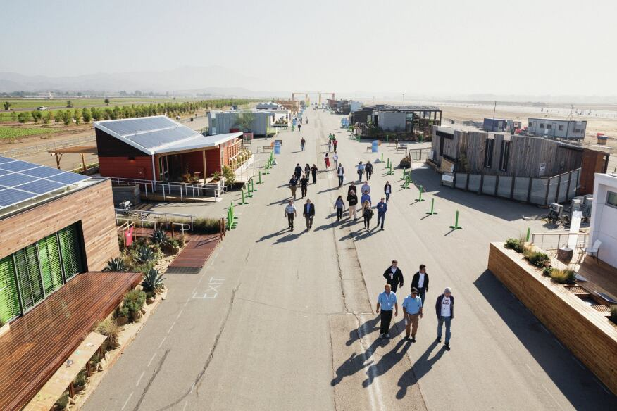 Visitors stroll down Decathlete Way.