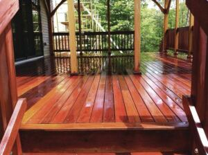 This eight-year-old ipe deck has just been cleaned and will be ready for a new oil finish once it dries out. The beautiful tone of the water-soaked decking is a good indication of what its finished appearance should look like.