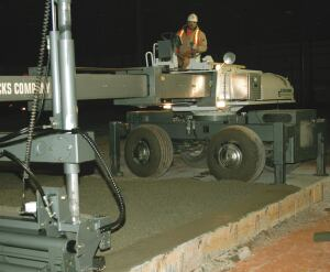 Fricks places concrete with a 3-inch slump—lower than most contractors. Laser screeds can place concrete even at 0-inch slump, but the boom must travel more slowly, and two passes may be necessary to get the elevation of the slab right.