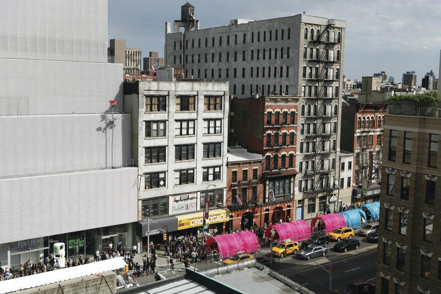 Worms, an installation for the New Museum's inaugural Ideas City festival in 2011 in New York, rethought the typical street fair tent as a colorful, tube-shaped structure made of parachute fabric and bent steel frames to hold a variety of programs.
