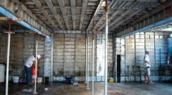 Shown here are the basic elements of an aluminum forming system: wall panels, deck panels, intermediate beams, and stay-in-place shores.