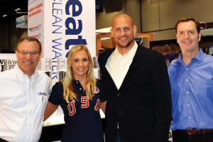 Looking ahead to the 2016 Games: Celebrating the renewed sponsorship deal are (L-R) Howard Smith, CEO, Pleatco; Mariya Koroleva, USA Synchro National Team; Kevin Warner, CEO, USA Synchro; and Battista Remati, CMO, Pleatco. (Photo: Pleatco, LLC)