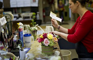 Employee Amy Merritt prepares a flower arrangement at Flowers By Julia in Princeton, Illinois, U.S., on Monday, June 11, 2012. The National Federation of Independent Business (NFIB) is scheduled to release small business optimism data on June 12. Photographer: Daniel Acker/Bloomberg via Getty Images